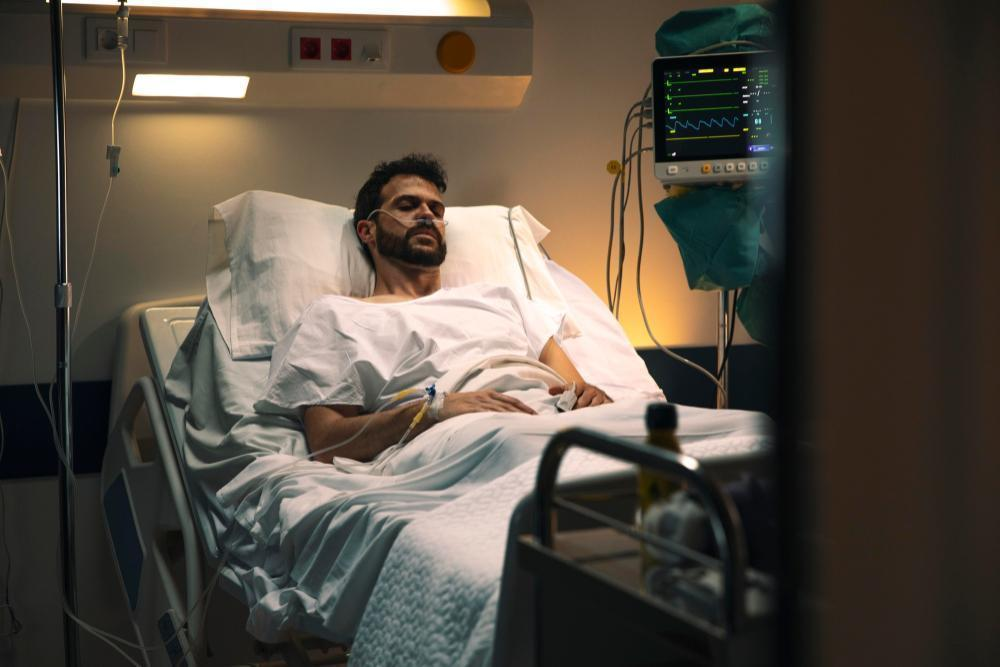 young man being ill hospital bed